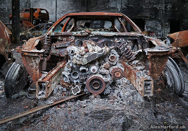 car-showroom-post-apocalyptic-burnt-out-car-engine.jpg