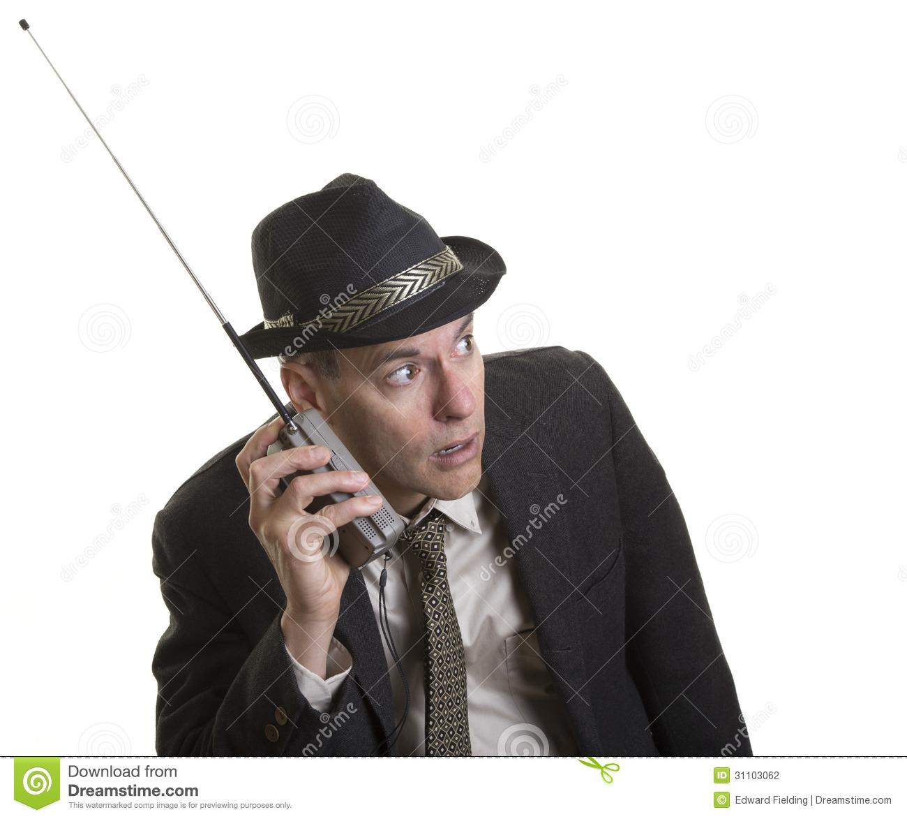 man-listening-intently-to-portable-radio-carefully-broadcast-news-sports-31103062.jpg